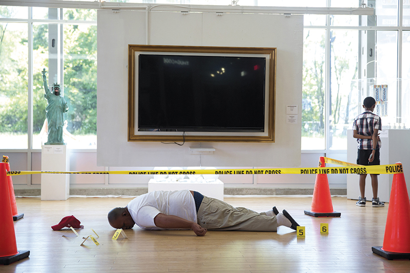 """Artist Ti-Rock Moore's piece """"Angelitos Negros"""" (the name is borrowed from Eartha Kitt's 1950s song, also titled """"Little Black Angels,"""" which played in the background at the installation) shows a simulation of Michael Brown's body after he …"""