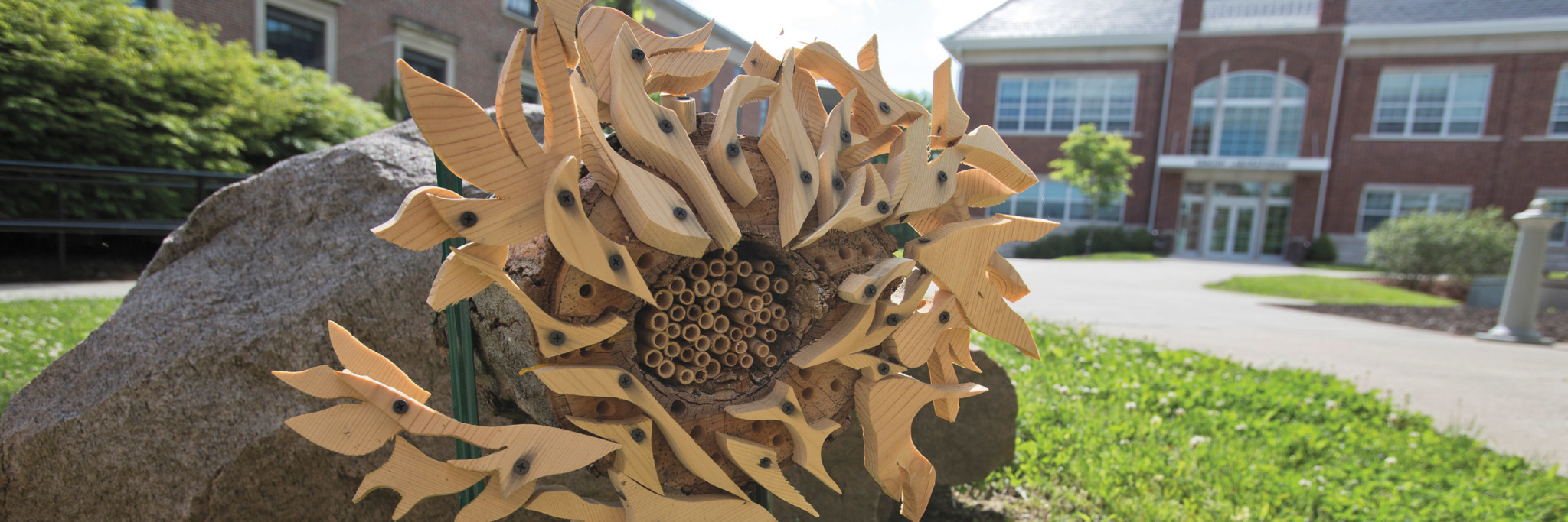"""The """"bee hotels,"""" a collaboration between a mixed media sculpture course and a biology course, decorate campus."""