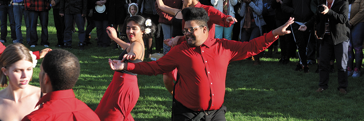 Juan Bernabe performs with fellow dancers on the Common during D-Day