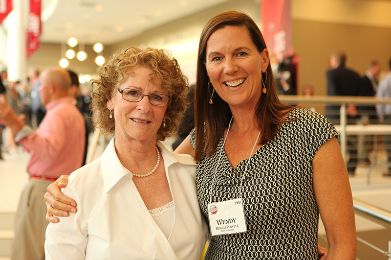Senior Associate Director of Athletics Lynn Schweizer has been building strong athletes and life-long relationships for 44 years, here with 2016 Hall of Famer Wendy Briggs Powell '88.