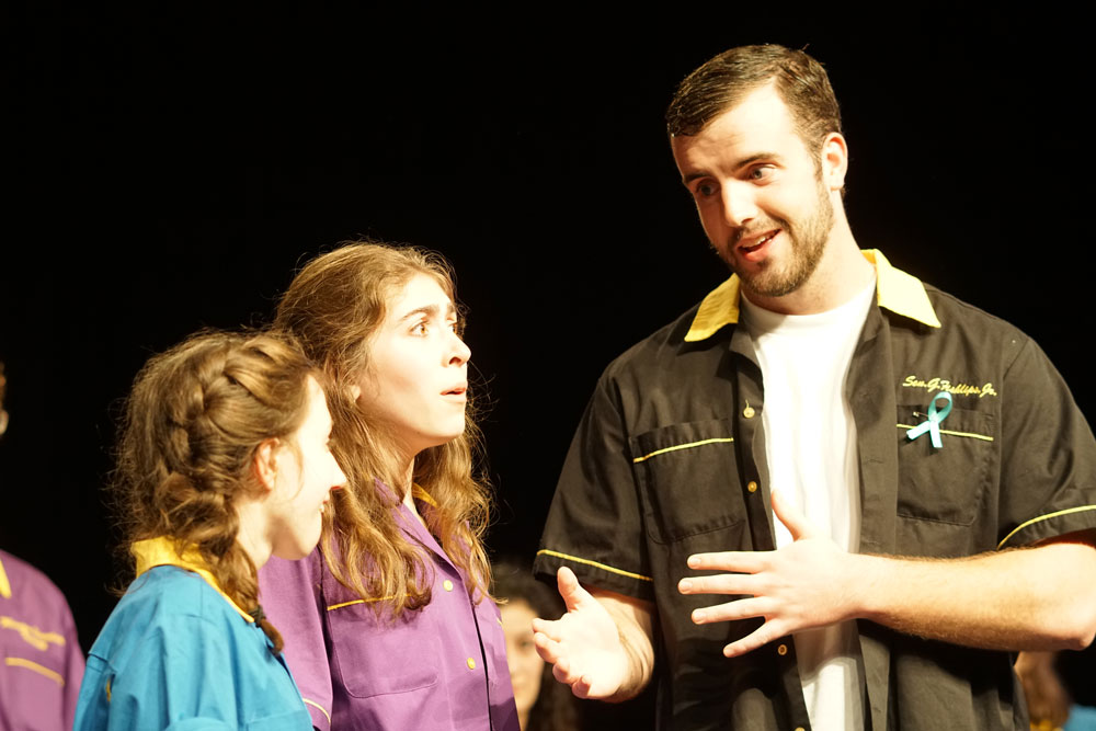 McMaster improvising a scene with other members of Burpees Seedy Theatrical Company