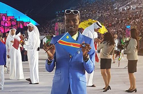 Dee Salukombo with small flag