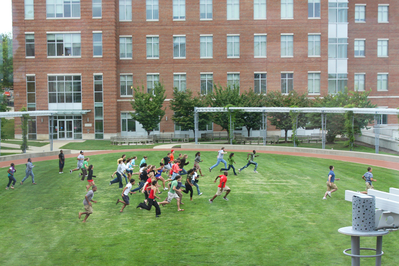 Students running on the common