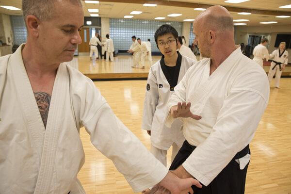 Winters and Tangeman demonstrate correct positioning for a seminar student.