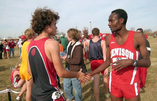 Dee Salukombo shaking hands