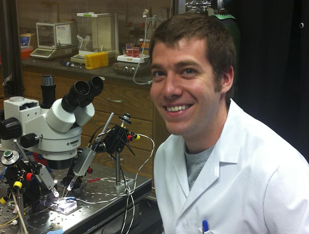 Adam Van Dyke, '08, in the lab.