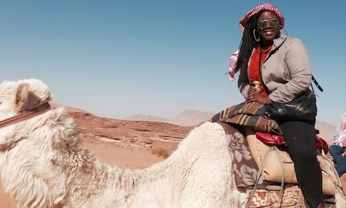 Keylee Jones sitting on camel