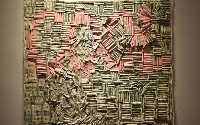 "Wall of one dollar bills creating the word ""Cool"""