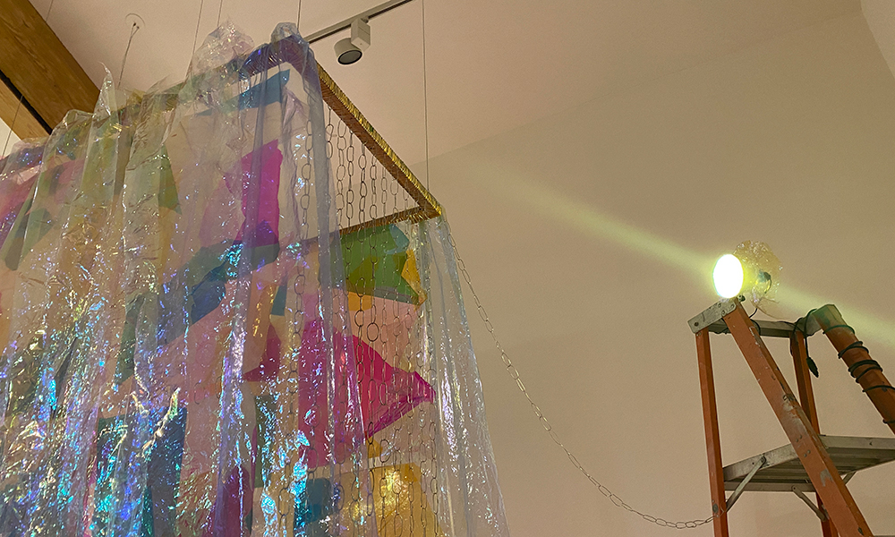 """And Life Flows on Within and Without You, cellophane, wood, aluminium wire, ladder, and rolling cart. 120"""" x 34"""" x 46"""". 2021."""