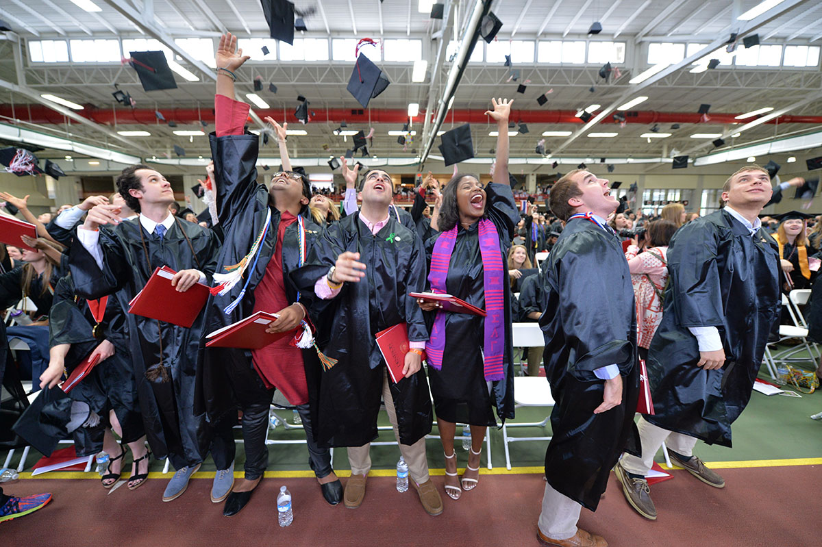 Students tossing their caps at commencement