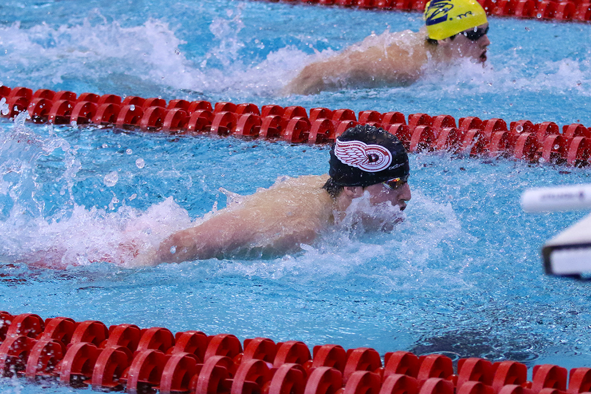 Denison student athletes competitively swimming