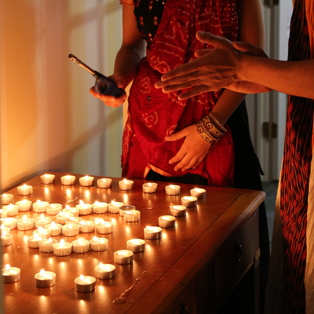 Lighting candles at Diwali celebrations