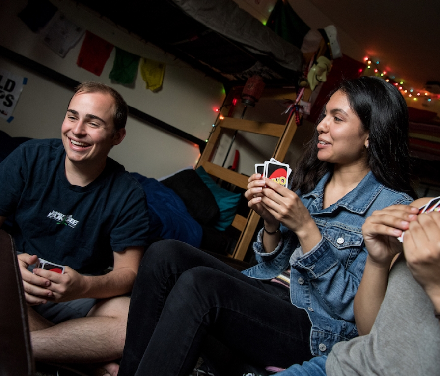 Students playing Uno in a residential dorm room