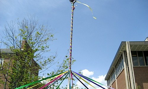 colored ribbon around a pole for maypole