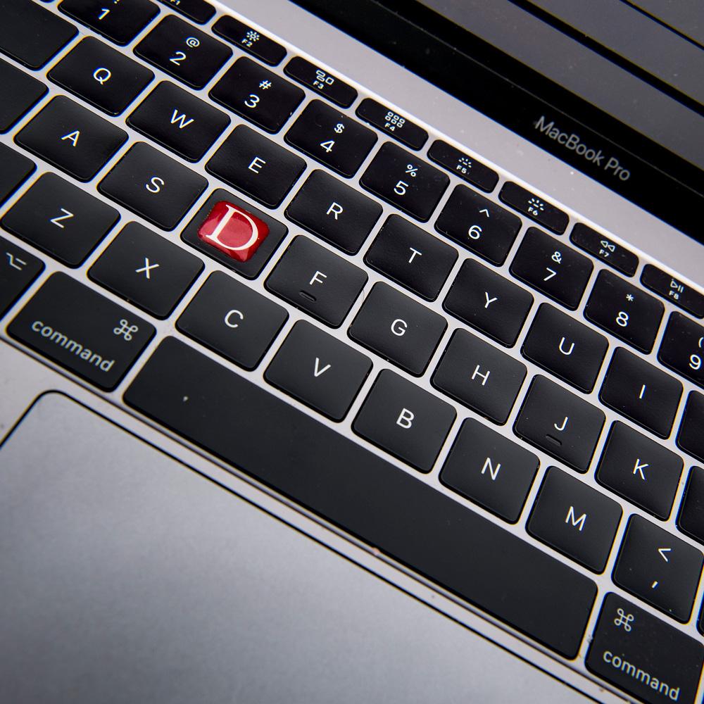 Computer keyboard with Denison D sticker