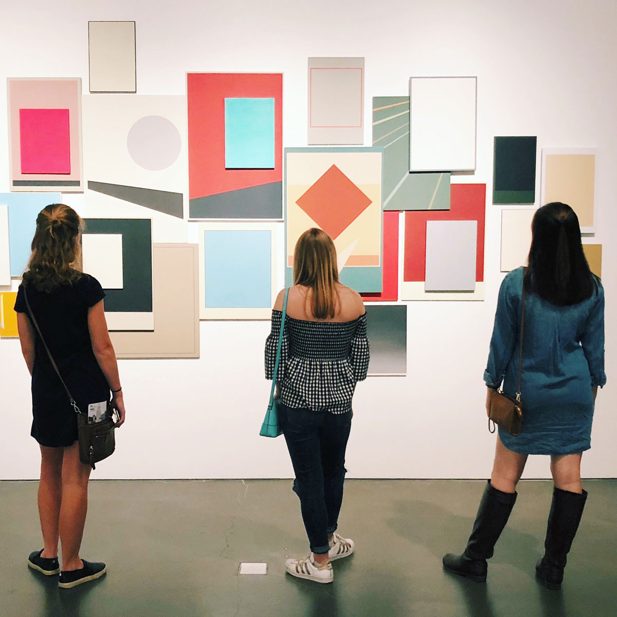 Students looking at art in a museum