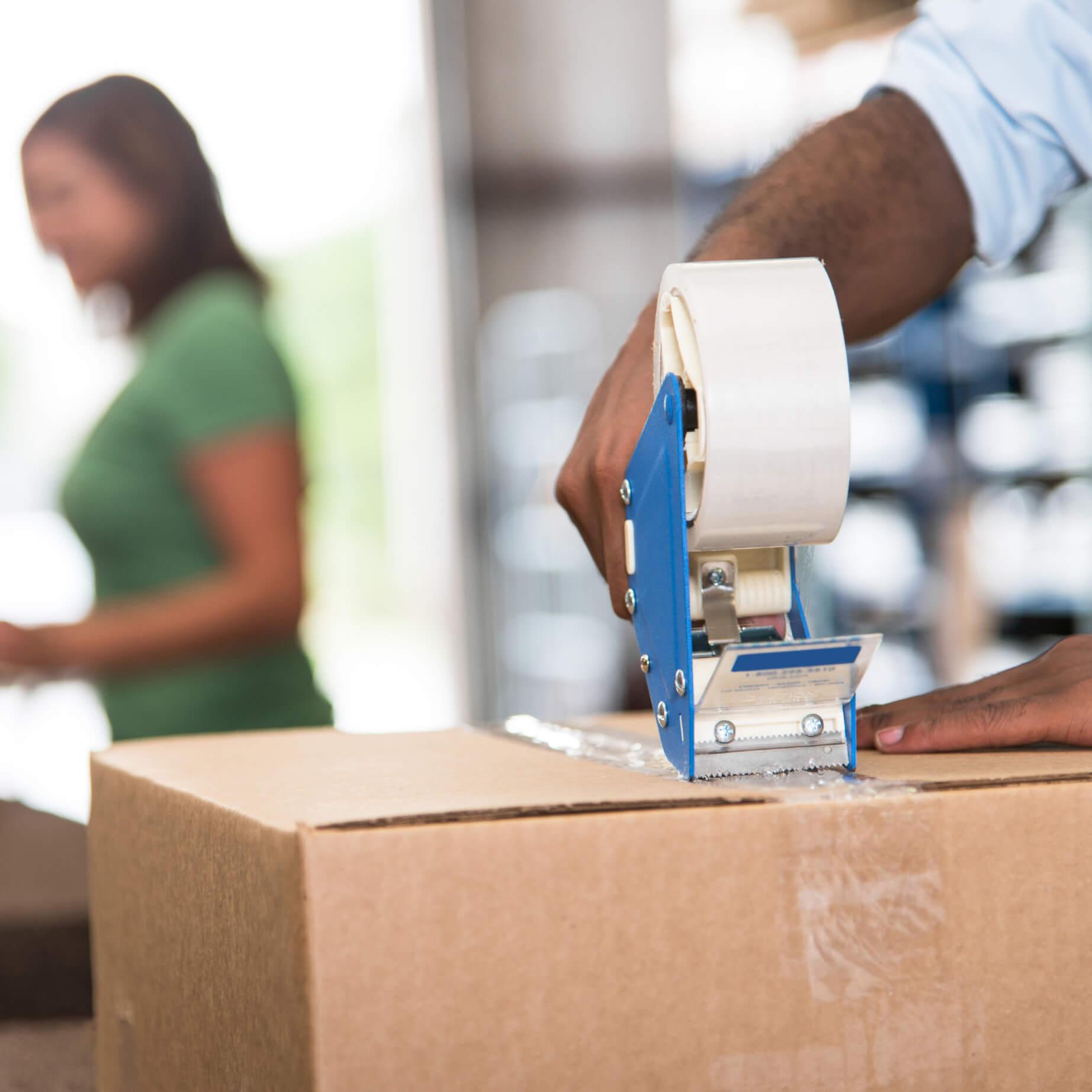 taping a cardboard box