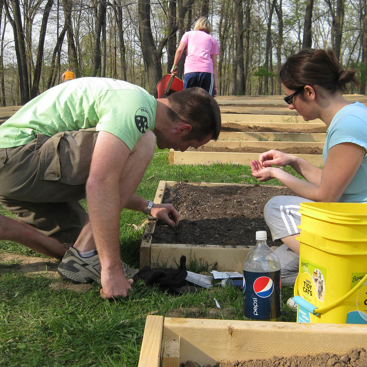 Faculty and staff planting seeds in the Denison Community Garden.