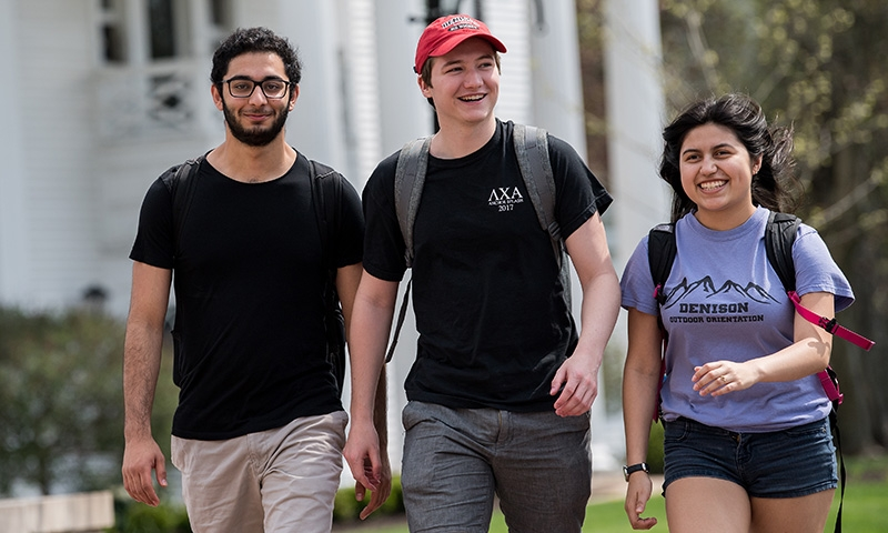 Three students walking around campus