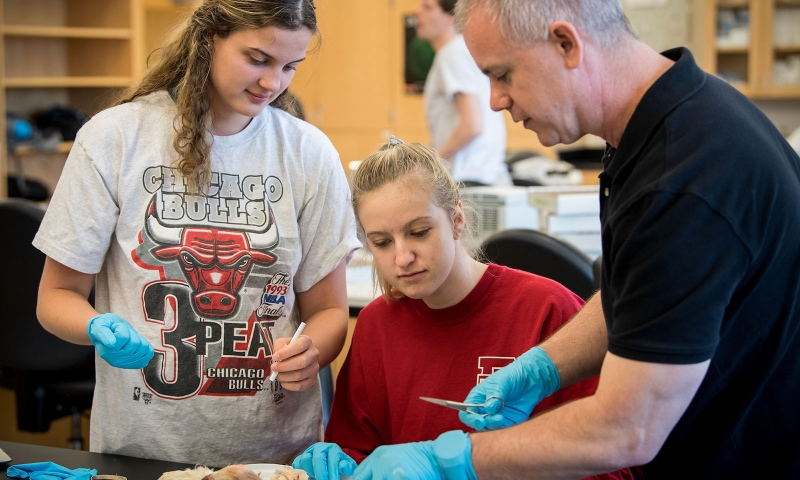 Prof. Eric Winters in a lab with students