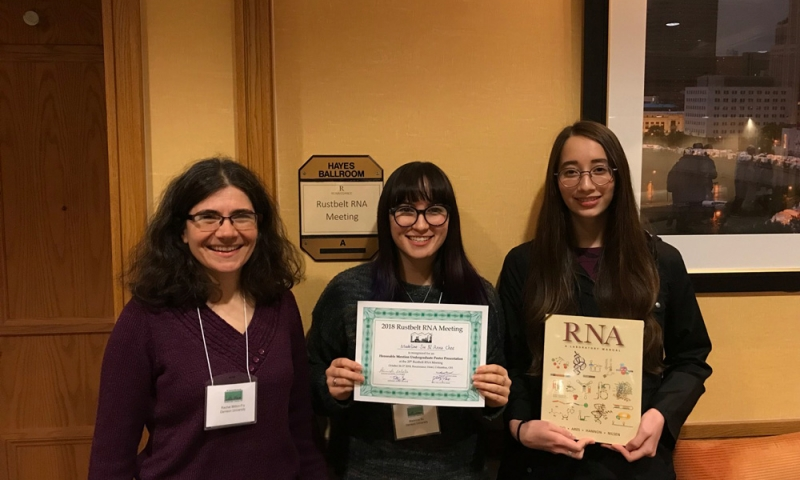 Students and recent alumni at a conference with Associate Professor of Chemistry Rachel Mitton-Fry