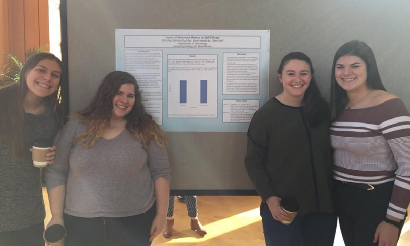 Psychology students with poster