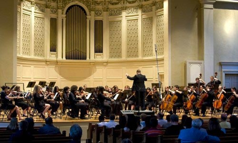 Photo of the Denison University Orchestra in concert, directed by Philip Rudd