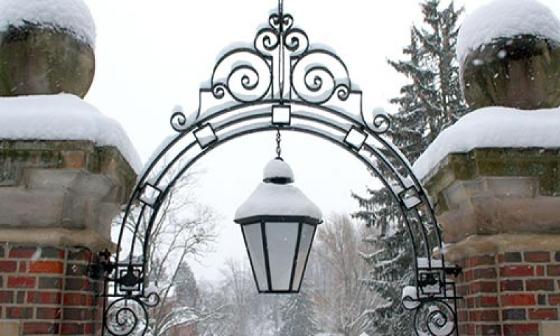 Photo of a campus gate with snow in winter
