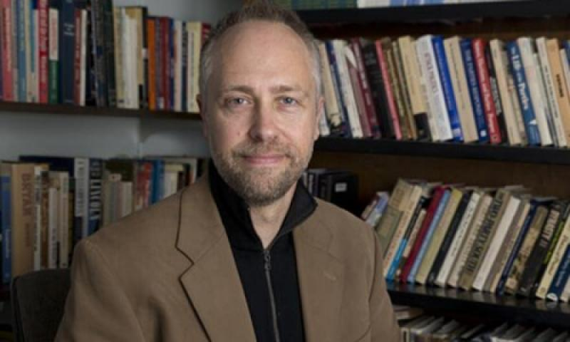 Image of Paul Djupe in front of a bookshelf