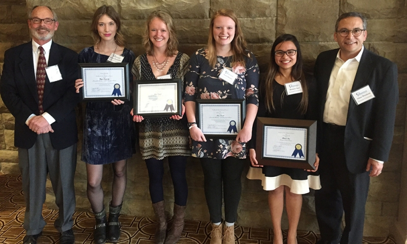 Melanie Amo '18, President Weinberg and a few others in a group photograph with awards