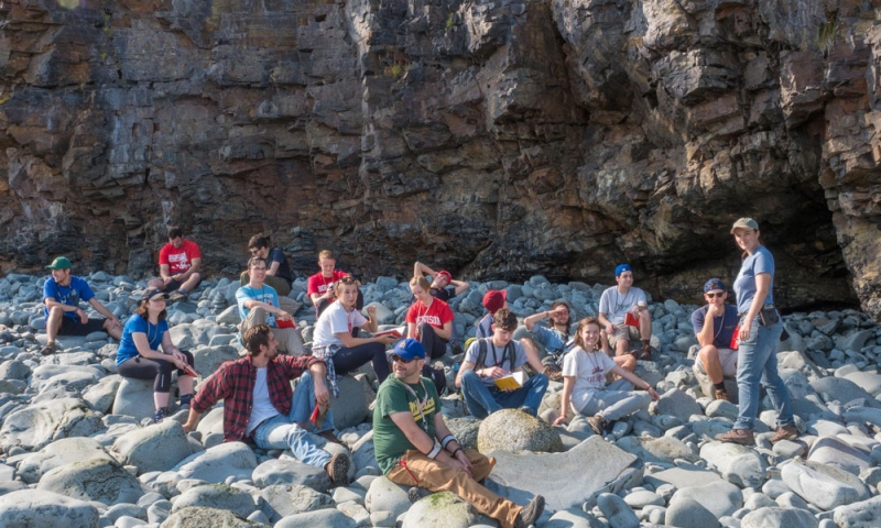 Group of students sitting on the rocks