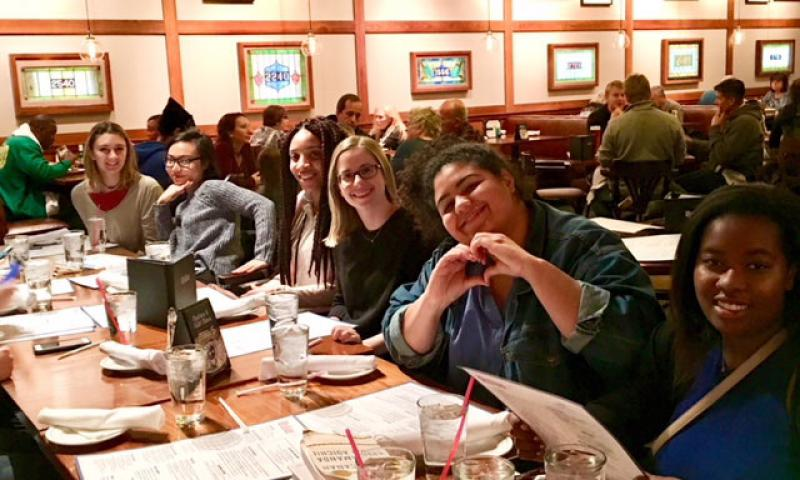 students socialize over a dinner