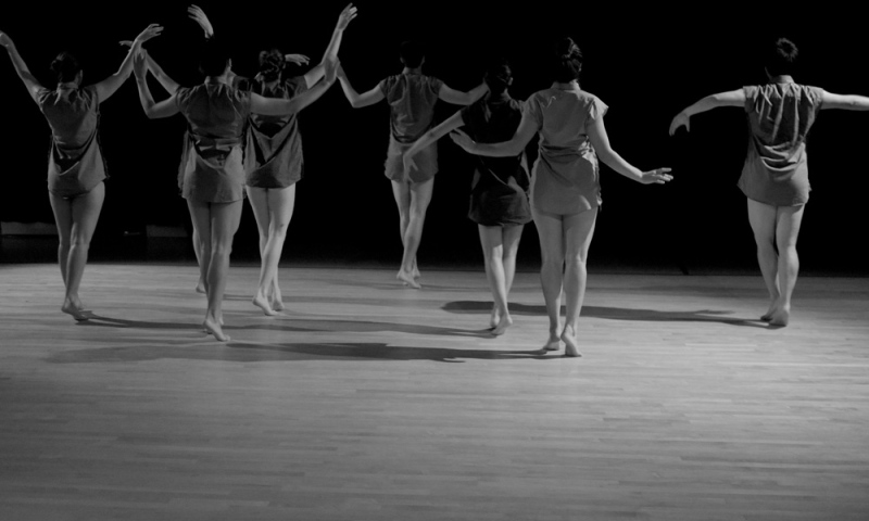 Students dancing - an image taken from behind