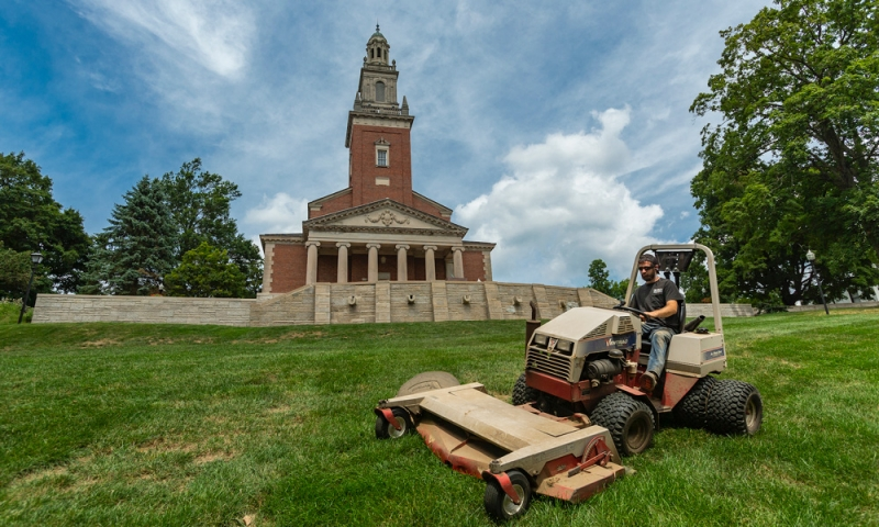 Denison's grounds crew maintaining landscape near Swasey Chapel