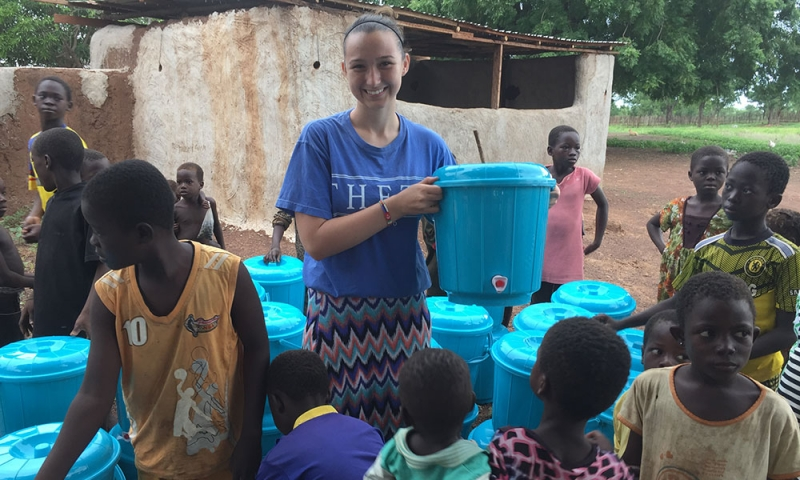 Alexandria Seward '19 among fresh water containers