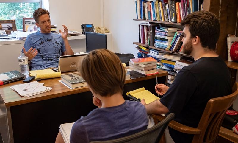 Professor John McHugh, Benjamin Keller '19 and Audrey Kirkley '20