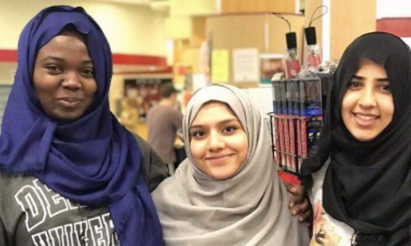 Students trying on the hijab