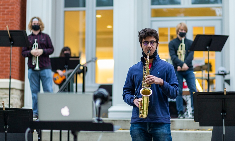 students performing outside eisner