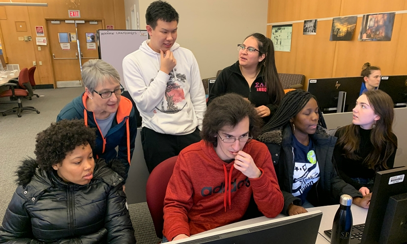 Professor and students work on an audio stories for the Podcast-a-thon