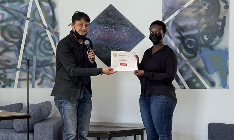 Sangeet Kumar presents certificate to Fellow, Martha Kamikazi
