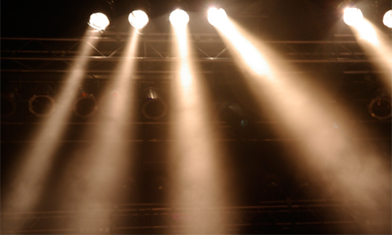 Photo of stage lights against a dark background