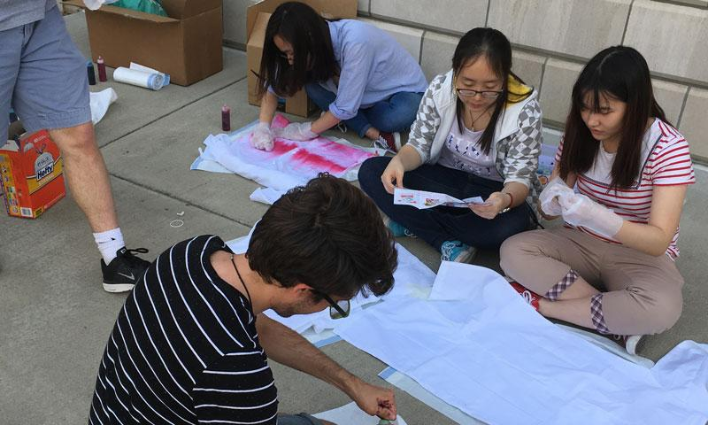 students tie dying lab coats
