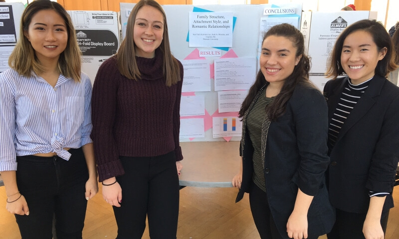 4 Students with Poster