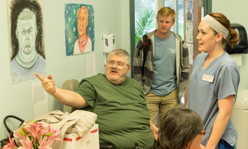 Residents of Flint Ridge Nursing and Rehabilitation Center viewing his personal portrait