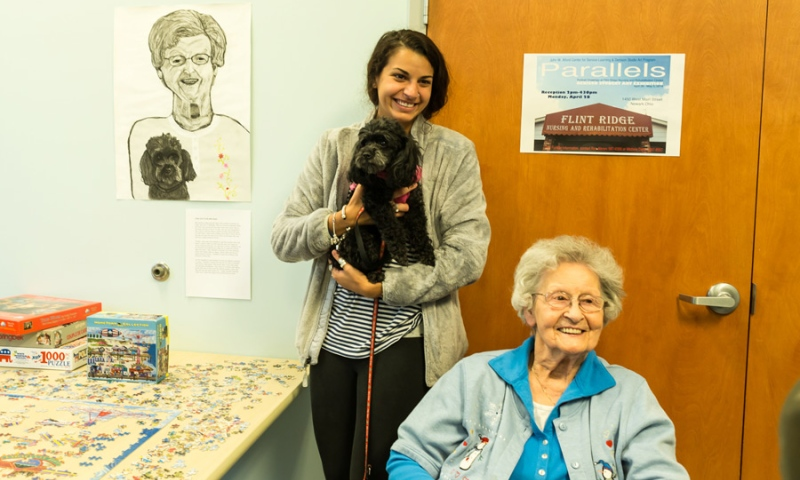 Student with a dog and a resident of Flint Ridge Nursing and Rehabilitation Center