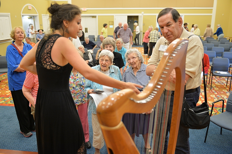Harpist Clemente answers questions from Kendal audience.