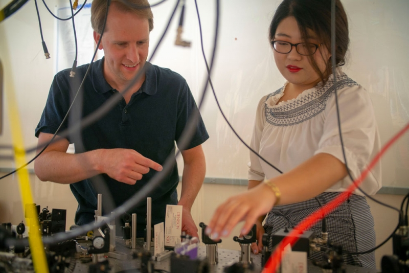 Professor Steven Olmschenk with Cornelia Wang '19
