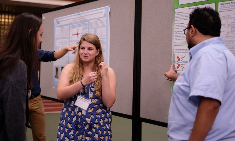 Students at the summer scholars poster fair