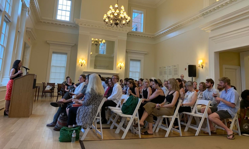 Conference Photo—Executive Editor Allison Wright recalls a week of workshops, readings, and panels at the reception concluding the Writers' Conference.