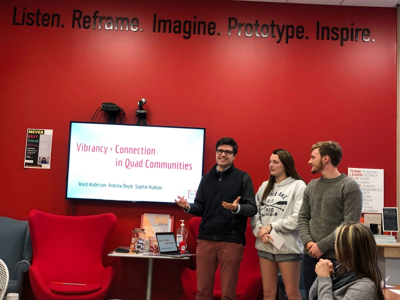 Group of students giving presentation with Powerpoint